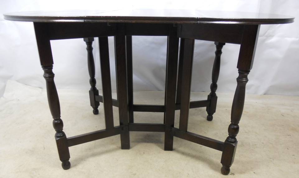 dark oak large gateleg dining table to seat six sold