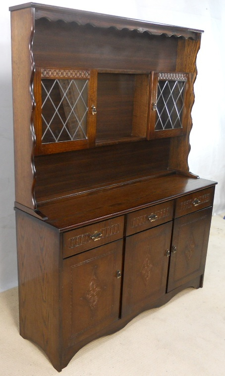 Oak Wood Dressers ~ Dark oak wood dresser with glazed plate rack in a country