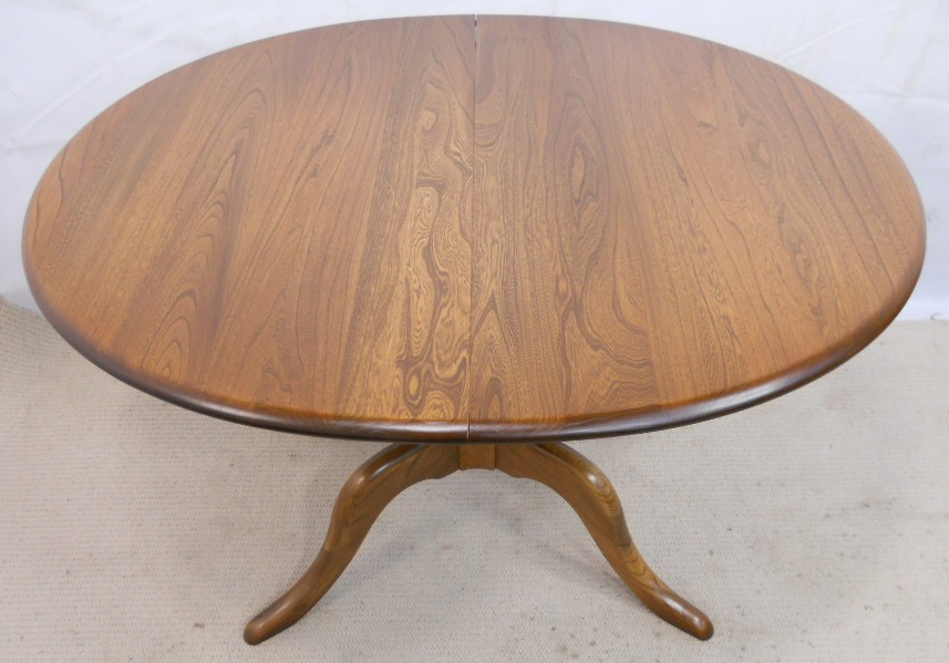 Ercol golden dawn extending pedestal elm dining table sold for Good quality dining tables