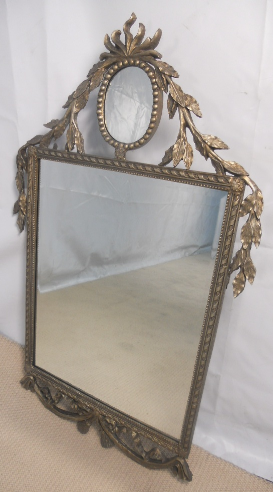 large decorative silver gilt wall mirror