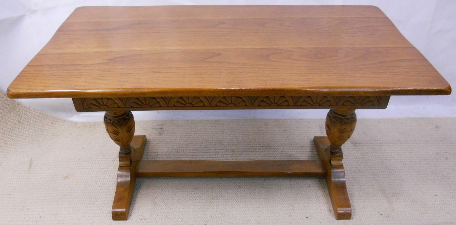 Light oak refectory style long coffee table with carved base Light oak coffee tables