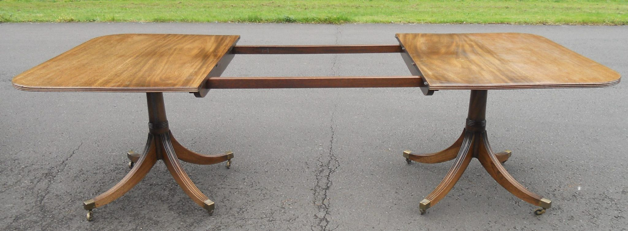 Mahogany twin pillar dining table to seat ten for Pillar dining table