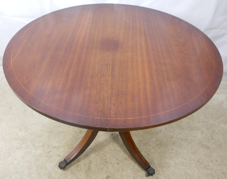 regency style round mahogany extending dining table to