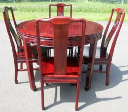 hard wood round extending dining table and eight matching dining