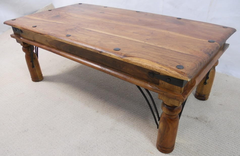 Rustic hard wood coffee table with bolted ironwork