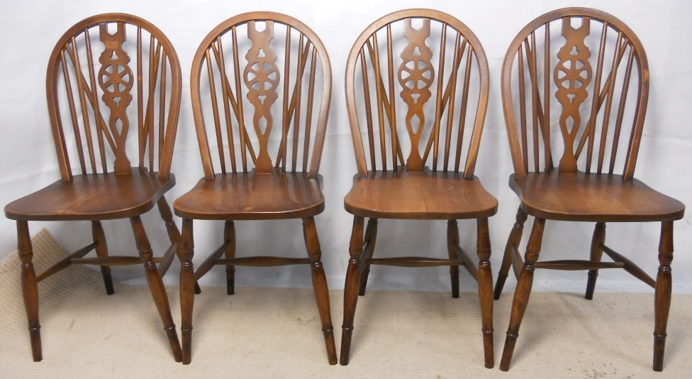 Windsor style kitchen dining chairs are in nice condition circa 1960