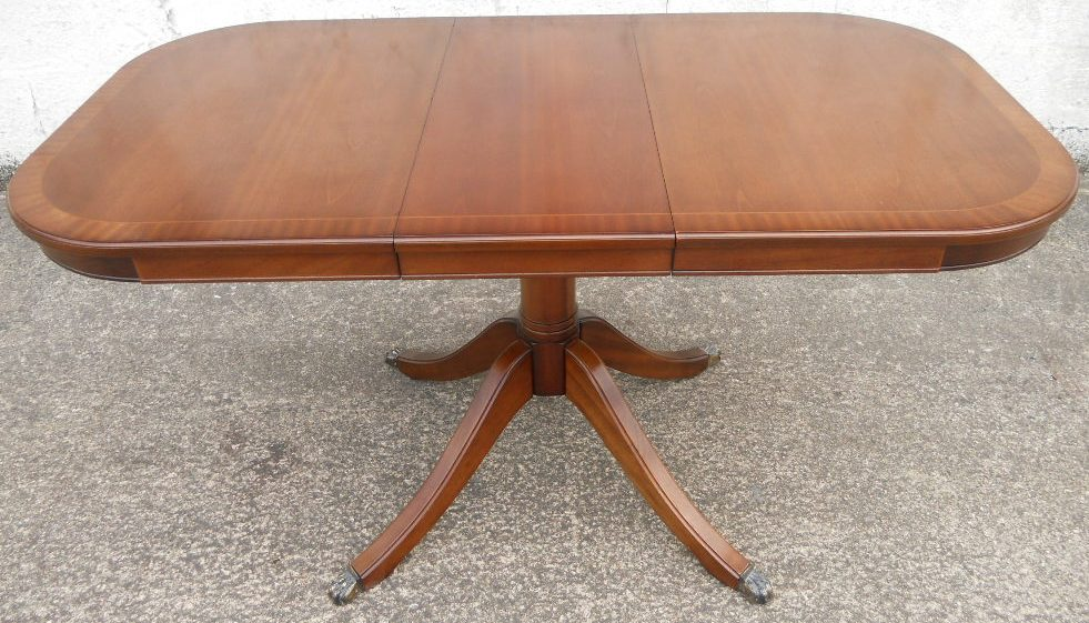 small mahogany extending dining table to seat six by strongbow sold. Black Bedroom Furniture Sets. Home Design Ideas