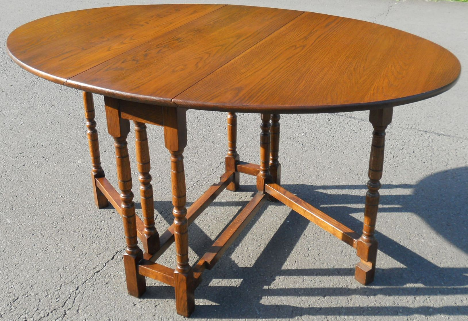 sold oak oval gateleg dining table to seat six. Black Bedroom Furniture Sets. Home Design Ideas
