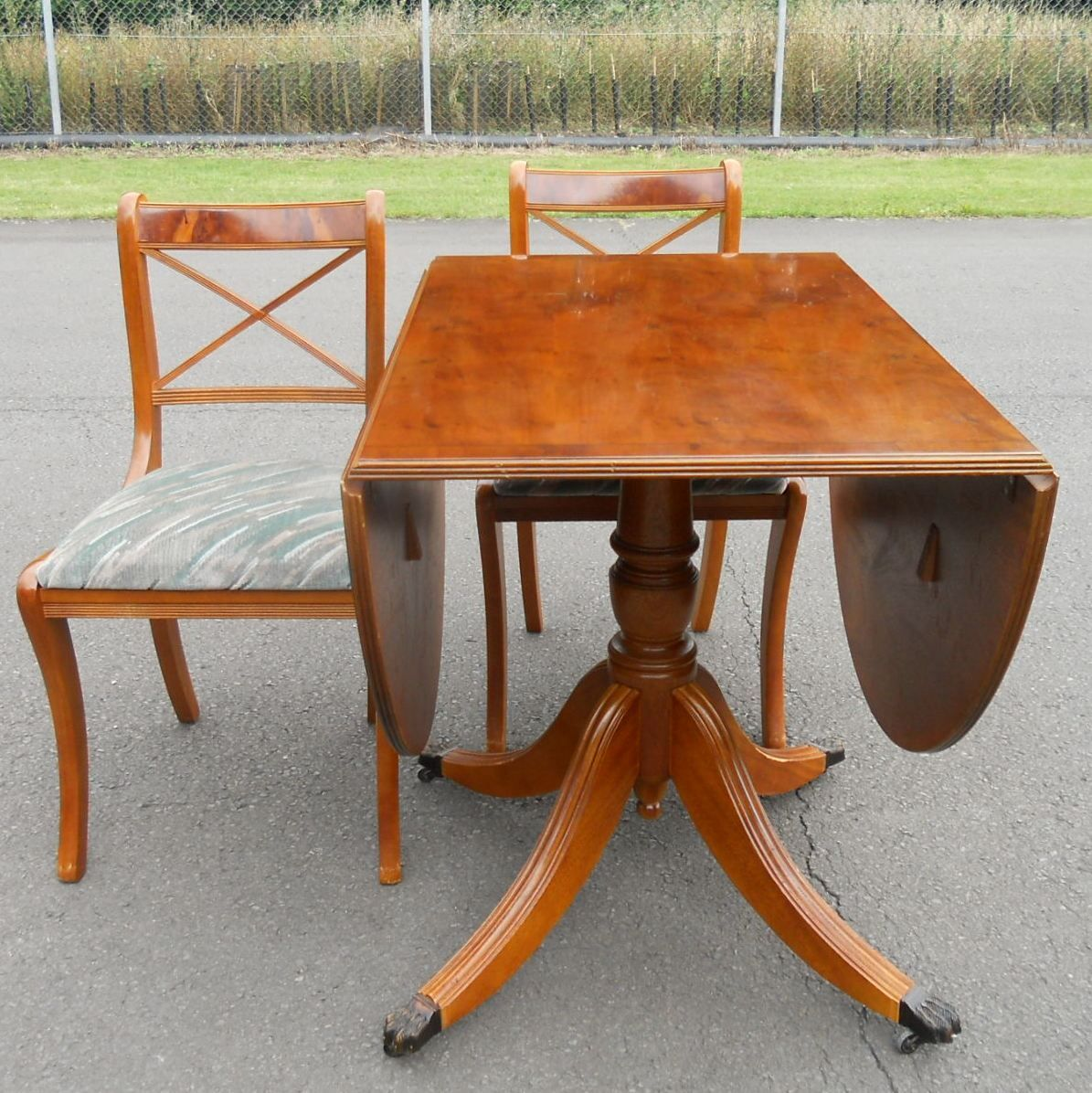 SOLD Yew Oval Dropleaf Dining Table