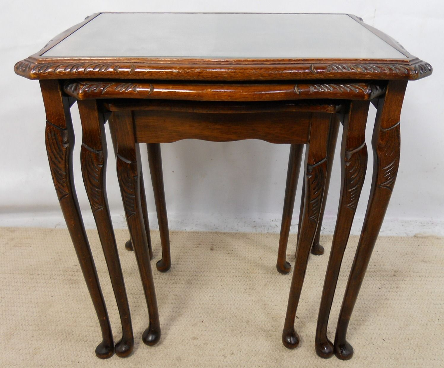 walnut nest of three leather top coffee tables sold. Black Bedroom Furniture Sets. Home Design Ideas