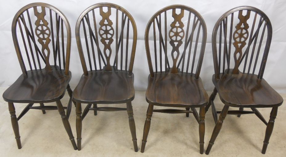 & Set of Four Dark Elm Wheelback Windsor Dining Chairs -SOLD